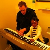 smiling-ears-piano-lessons-in-ny